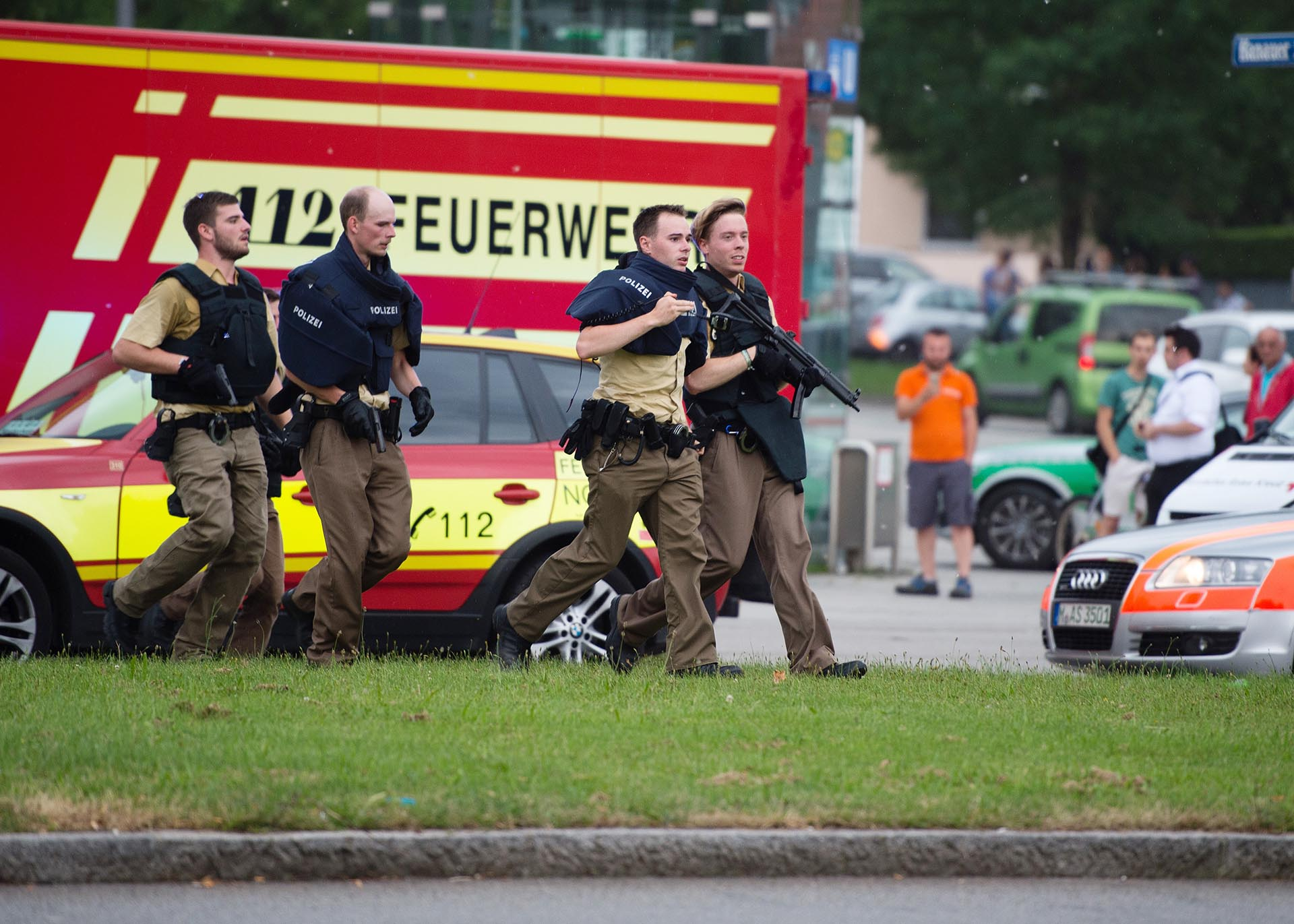 Policemen arrive at a shopping centre in which a shooting was reported in Munich, southern Germany, Friday, July 22, 2016. Situation after a shooting in the Olympia shopping centre in Munich is unclear. (Matthias Balk/dpa via AP)