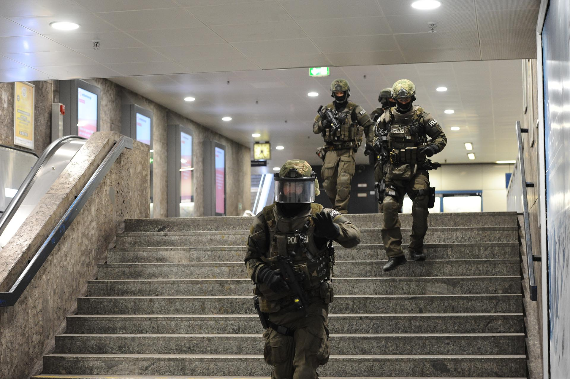 Heavily armed police forces walk through the underground station Karlsplatz (Stachus) after a shooting in the Olympia shopping centre was reported in Munich, southern Germany, Friday, July 22, 2016. (Andreas Gebert/dpa via AP)