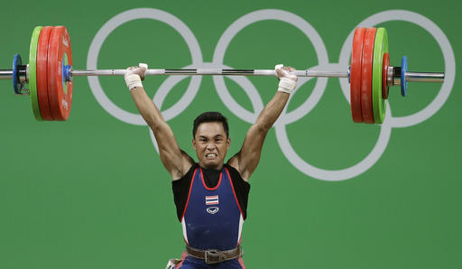 Sinphet Kruaithong, of Thailand, competes in the men's 56kg weightlifting competition at the 2016 Summer Olympics in Rio de Janeiro, Brazil, Sunday, Aug. 7, 2016. (AP Photo/Mike Groll)