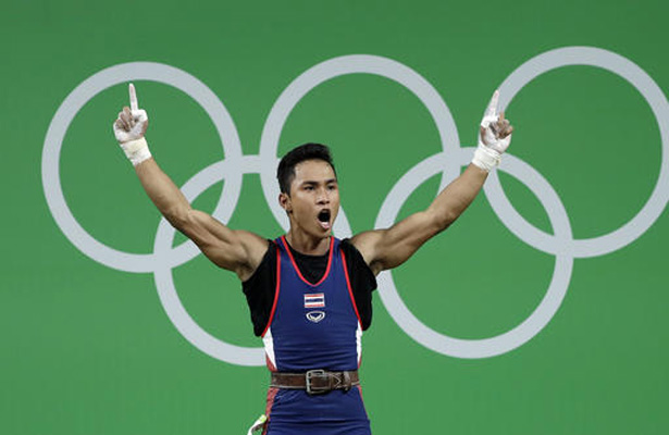 Sinphet Kruaithong, of Thailand, celebrates a successful lift in the men's 56kg weightlifting competition at the 2016 Summer Olympics in Rio de Janeiro, Brazil, Sunday, Aug. 7, 2016. (AP Photo/Mike Groll)